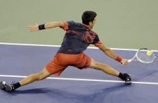 Djokovic advances despite fighting in stand