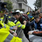 Garda and crowds clash as protesters demonstrate against Tony Blair book signing his memoirs 'A Journey' inside Eason's on O'Connell St, Dublin.
