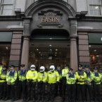 Gardai line the shop front of Eason's bookstore as former Prime Minister Tony Blair attends his first book signing in Dublin.