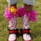 A man shows off his customised wellies.