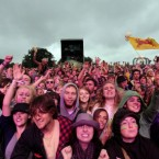 Crowds watch Mumford and Sons on stage yesterday.