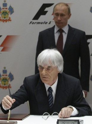 F1 boss Bernie Ecclestone signs the deal to confirm the Russian Grand Prix while Russian prime minister Vladimir Putin watches.