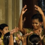 Michelle Obama dances with underprivileged children at the Mumbai University in Mumbai, India, today. (AP Photo/Rajanish Kakade)