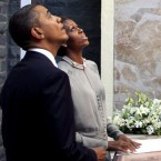 Barack and Michelle Obama pay tribute at the memorial for the Nov. 26, 2008 terror attack victims at the Taj Mahal Palace and Tower Hotel in Mumbai. (AP Photo)