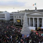 Thousands of protesters hold a rally outside the General Post Office in central Dublin, Ireland, Saturday, Nov. 27, 2010. Some 10,000 labor union supporters marched through Dublin Saturday in Ireland's biggest demonstration yet against severe budget-cutting plans and a looming EU-IMF bailout.(AP Photo/Peter Morrison)