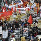 Thousands of protesters march through central Dublin, Ireland, Saturday, Nov. 27, 2010. Some 10,000 labor union supporters marched through Dublin Saturday in Ireland's biggest demonstration yet against severe budget-cutting plans and a looming EU-IMF bailout. (AP Photo/Peter Morrison)