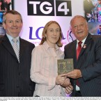 Kerry's Geraldine O'Shea takes her award from Pat Quill, right, President, Cumann Peil Gael na mBan and Pól Ó Gallchoir, TG4 at Croke Park last night.