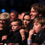 Happy families: Victoria and David Beckham during the BBC Sport Personality of the Year Awards at the LG Arena, Birmingham.