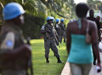 UN soldiers from Senegal stand guard in Abidjan, Ivory Coast.