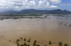 Queensland city facing further flood damage as waters continue to rise