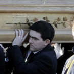 Michaela's brother Mark Harte carries her coffin from her parents' home in Ballygawley, Co Tyrone this morning.