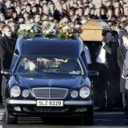 John McAreavey carries the coffin of his wife Michaela from her family home in Ballygawley to her funeral service.