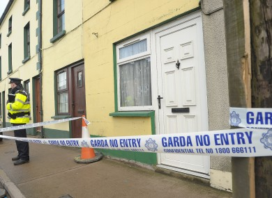 A garda stands outside the house at Ballybay, Co Monaghan, yesterday.