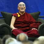The Dalai Lama laughs as he speaks to students, faculty, and guests at Florida Atlantic University in Boca Raton, Florida.