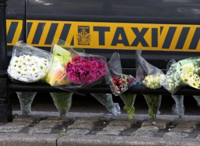 Flowers left at the taxi rank where Derrick Bird shot and killed a driver in June 2010.