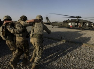 A soldier is helped onto a US Army medical evacuation helicopter in Southern Afghanistan.