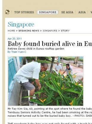 Local media accompanied Mr. Tay Kim Sia to the spot where he found the baby boy