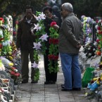 Chinese people arrange flowers to put on the tomb of a deceased relative at a cemetery on the Qingming Festival in Beijing, also known as Grave Sweeping Day, when the Chinese honour their lost loved ones.