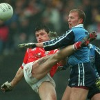 Shane Ryan of Dublin and Mark O'Sullivan of Cork collide during the sides' 1999 National Football League meeting.