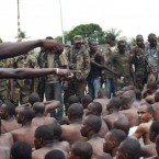 Soldiers loyal to Alassane Ouattara point to men they claim to recognise among several dozen prisoners captured during fighting and patrols in Abidjan, Ivory Coast earlier this week.