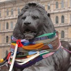 A statue in Trafalgar Square, London gets a lion-sized scarf. Image: Stefan Rousseau/PA Images.