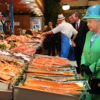 Queen Elizabeth visits the stand of fishmonger Pat O'Connell at the English Market in Cork City. (Maxwells)
