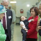 At UCC's Tyndall Institute, Her Majesty meets Angie Benhaffaf (far right) with her twins Hassan and Hussein (held by Sinead O'Sullivan). Also present was Cork native Dr Edward Kiely, who operated on the formerly conjoined twins in London. (Maxwells)