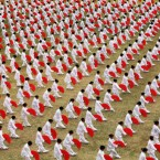 Over 1,000 workers perform the Taichi Fan at the opening ceremony of the second Xuchang Workers Sports Games in Xuchang city, China. (Niu shupei/AP/Press Association Images)