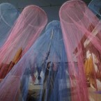 Pakistani Khalid Akeel, 13, organises mosquito nets to attract customers outside the shop where he works in the Pakistani town of Taxila. (AP Photo/Muhammed Muheisen)