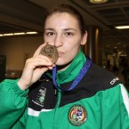 Katie Taylor kisses her gold medal from the European Union Boxing Championships in Dublin Airport last night.