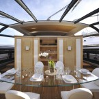 The yacht has a glass-covered atrium for dining...