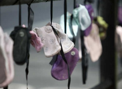 Children's shoes hung as a protest against clerical sexual abuse of children