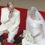 Prince Albert II of Monaco speaks to his bride Charlene Princess of Monaco during their religious wedding ceremony at the Monaco palace