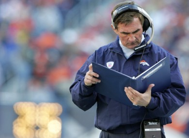 Mike Shanahan: deciphering his own handwriting.