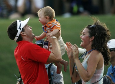Bradley celebrates with his 10-month-old nephew Aiden Keegan Bradley and his sister Madison on the 18th green.