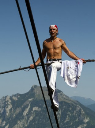 Freddy Nock walking up the rope of a cable car in Ebensee, Austria on Monday