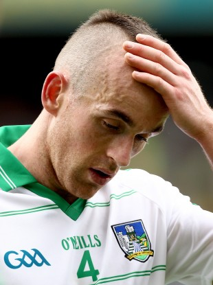 Steven Lavin feels his head, perhaps in disbelief, after Limerick's loss to Kerry.