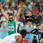 Ireland's Brian Gregan celebrates victory in his semi-final of the men's 400m at the World University Games in Shenzhen, China.