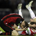 Aidan Price and David McMillan struggle after a clash of heads during Monday's Airtricity League match between Bohemians and St. Patrick's Athletic at Richmond Park.