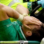 David Wallace is stretchered off during yesterday's game against England. The Munster flanker was ruled out of the Rugby World Cup with a knee ligament injury.