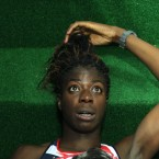 At the IAAF World Championships, a distraught Christine Ohuruogu tries to come to terms with being disqualified from the women's 400m heats after a false start.