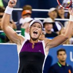 US Open winner Sam Stosur flexing her biceps. 