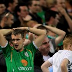 Ireland fans look dejected at the final whistle.