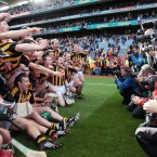 The Kilkenny hurlers celebrate with the Liam MacCarthy Cup after Sunday's All-Ireland SHC final.