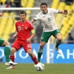 Russia's Andrey Arshavin and Keith Andrews.