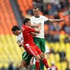 Ireland's Glenn Whelan jumps with Igor Semshov of Russia.