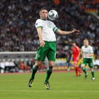 Robbie Keane controls a high ball. 