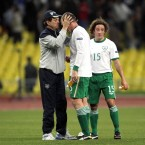 Fitness coach Fausto Rossi embraces Richard Dunne.