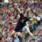Stephen Cluxton beats Kieran O'Leary to the high ball.