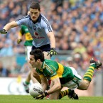 Tom O'Sullivan follows Dermot Connolly to ground.